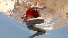 Kinky Ala underwater swims naked Thumb